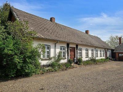 Landbrugs- og udlejningsvirksomhed beliggende mellem Jelling og Bredsten
